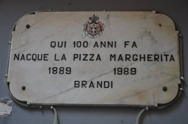 "Here, one hundred years ago, the ""Pizza Margherita"" was born 1889/1989 Brandi. (Brandi in one of the most ancient pizzeria of the city)"